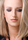Close up portrait of blond woman beauty with smokey eyes make Royalty Free Stock Photography