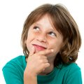 Close up portrait of boy looking up at corner. Royalty Free Stock Photography