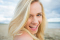 Close up portrait of cheerful relaxed blond at beach a young the Royalty Free Stock Images
