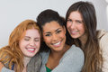 Close up portrait of cheerful young female friends on sofa at home Stock Images