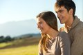 Close up portrait of couple outdoors at sunset. Royalty Free Stock Photography
