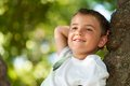 Close up portrait cute boy daydreaming tree Royalty Free Stock Photos