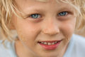 Close up portrait of cute boy a a happy who s been p laying in the sand Royalty Free Stock Image