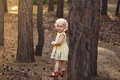 Close-up portrait of cute cheerful little girl in park Royalty Free Stock Photo