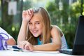 Close up portrait cute girl student desk garden Stock Photo