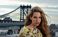 Close up portrait of fashion model with full sexy hair and red lips posing on rooftop location metal bridge construction Royalty Free Stock Photography