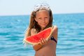 Close up portrait of girl eating watermelon. Royalty Free Stock Photography