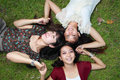 Close up portrait of girl friends lying down Royalty Free Stock Image