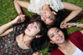 Close up portrait of girl friends lying down Stock Photography