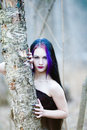 Close-up portrait of the gothic woman in the dark forest Royalty Free Stock Photo