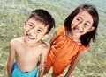 Close up portrait of happy asian kids in the beach smiling and looking at camera Stock Image