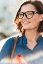 Close up portrait of a happy smiling woman in eyeglasses Royalty Free Stock Photo