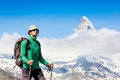 Close up portrait of hiker looking at the horizon in mountains on sunny day swiss alps matterhorn Stock Images