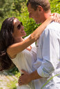 Close up portrait of hugging couple outdoors sunny park Royalty Free Stock Image