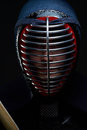 Close up portrait of kendo fighter on the dark background Royalty Free Stock Photos
