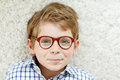 Close-up portrait of little blond kid boy with brown eyeglasses Royalty Free Stock Photo