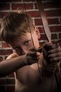 Close up portrait- little boy with bow and arrow Royalty Free Stock Photo