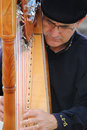 Close up portrait photograph busker streets france who shows such passion his face as playing his instrument images can be used to Royalty Free Stock Photography