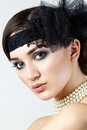 Close up portrait of retro styled woman with pearl necklace Royalty Free Stock Photography