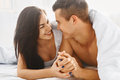 Close up portrait of romantic couple in bed Royalty Free Stock Photo
