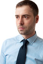 Close up portrait of serious business man on white thinking in blue shirt background Royalty Free Stock Photo