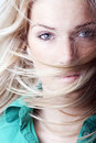 Close up portrait of a sexy blond woman beauty face with hairs floating with the wind Royalty Free Stock Image
