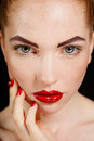 Close up portrait of sexy european young woman model with glamour make up and red bright manicure christmas makeup bloody red li Stock Image