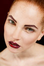 Close up portrait of sexy european young woman model with glamour make up and red bright manicure christmas makeup bloody red li Stock Images