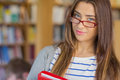 Close up portrait of a smiling female student in library standing the college Stock Photography