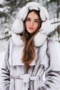 Close-up portrait of smiling girl in fur hood in w Royalty Free Stock Photo