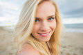 Close up portrait of smiling relaxed blond at beach a young the Stock Photos