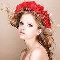 Close-up portrait of summer teenage girl with flower hairstyle. Royalty Free Stock Photo