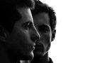 Close up portrait two  men twin brother friends silhouette Royalty Free Stock Photo