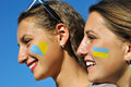 Close up portrait of two ukrainian teenage girls with painted symbols on faces Royalty Free Stock Image