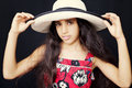 Close up portrait of a young african american girl with sun hat Royalty Free Stock Photo