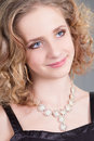 Close up portrait young attractive curly woman necklace Royalty Free Stock Photos