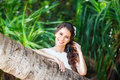 Close-up portrait young beautiful bride in a tropical jungle on Royalty Free Stock Photo