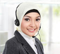 Close up portrait of young beautiful muslim woman customer service operator with headset on white background Royalty Free Stock Images