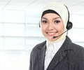 Close up portrait of young beautiful muslim woman customer service operator with headset on white background Stock Photo