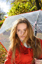 Close up portrait of young beautiful woman in autumn park with red umbrella leaves fall Royalty Free Stock Images