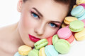 Close up portrait of young beautiful woman with colorful macaroons Royalty Free Stock Images