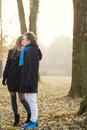 Close up portrait of young caucasian couple kissing standing together outdoors and Royalty Free Stock Photo