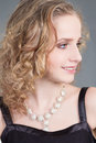 Close up portrait young curly woman over grey Royalty Free Stock Images