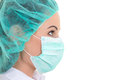 Close up portrait of young female doctor in mask over white Royalty Free Stock Image