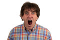 Close up portrait of young man  yelling with open mouth Royalty Free Stock Photo