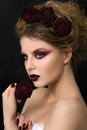 Close-up portrait of young woman with dark violet party make-up Royalty Free Stock Photo