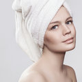 Close-up portrait of young woman with perfect health skin of face and bath towel on head.  on white Royalty Free Stock Photo