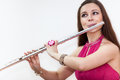 Close up portrait of young woman playing on flute, Royalty Free Stock Photo