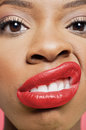 Close-up portrait of young woman with red lips grimacing Royalty Free Stock Photography