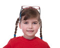 Close up portret of little girl with glasses on top of head isolated on white Royalty Free Stock Photos